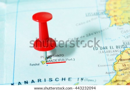 Close-up of a red pushpin on a map of Madeira island - travel concept - stock photo