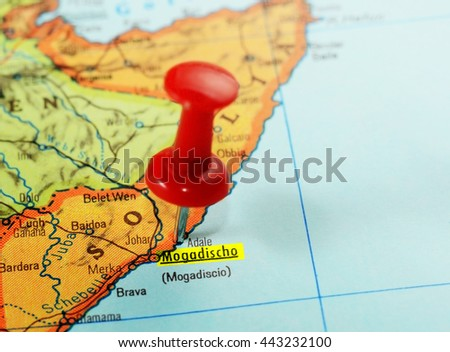 Close-up of a red pushpin on a map of Mogadishu, Somalia Africa - travel concept - stock photo