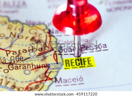 Close-up of a red pushpin on a map of  Recife  Brazil  - travel concept