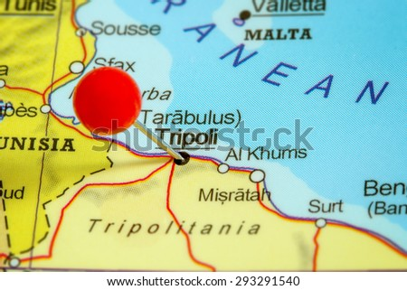 Close-up of a red pushpin on a map of Tripoli, Libya - stock photo