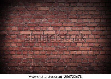 Close up of a Red Worn Brick wall - stock photo