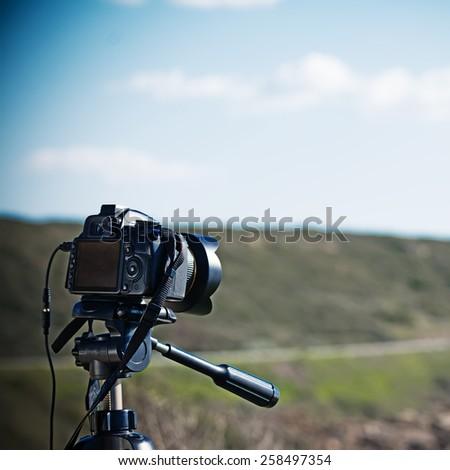 close up of a reflex camera on a tripod - stock photo