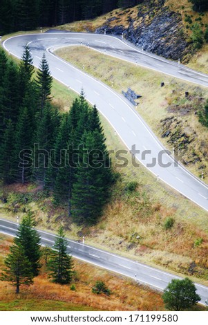 close-up of a road trough the countrside - stock photo