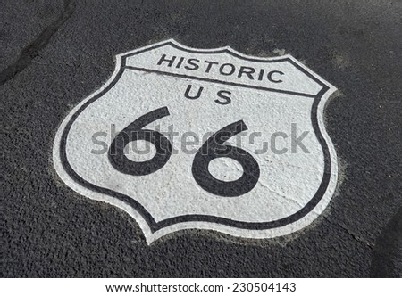Close-up of a route 66 sign on the highway.