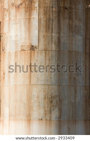 Close-up of a rusty metal reservoir tank - stock photo