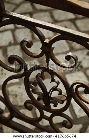 Close up of a rusty wrought iron balcony in France - stock photo