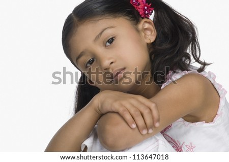 Close-up of a sad girl with her arms crossed - stock photo