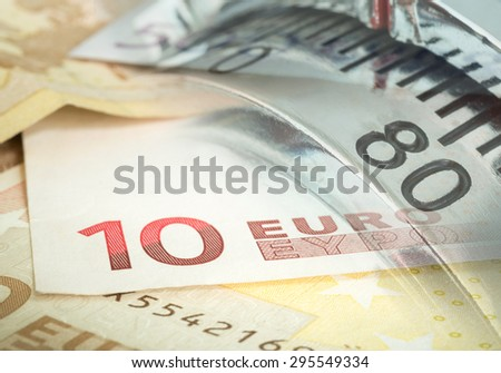 Close up of a safe lock with money euro, concept image suitable for security the euro.