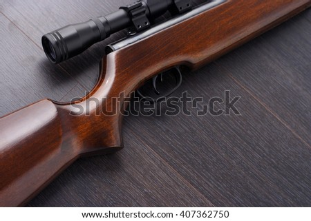 Close up of a scope mounted on a rifle - stock photo