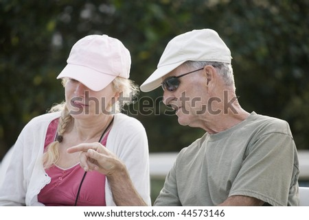 Close-up of a senior man talking to a senior woman - stock photo