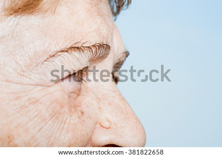 Close up of a senior woman's face - stock photo