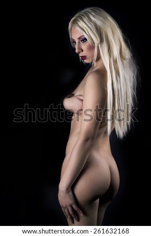 Close-up Of A Sexy Young Woman Covering Her Breast - stock photo