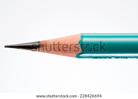 Close up of a Sharpened Pencil Isolated on White Background. Macro with Text Space - stock photo