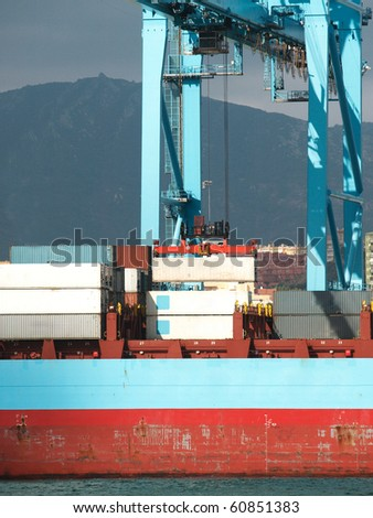 close up of a ship at a container terminal - stock photo