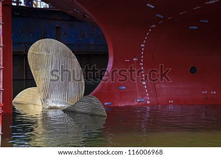 Close up of a Ship Propeller in water. - stock photo