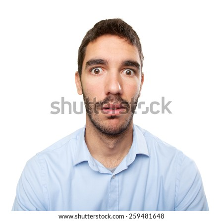 Close up of a shocked young man - stock photo