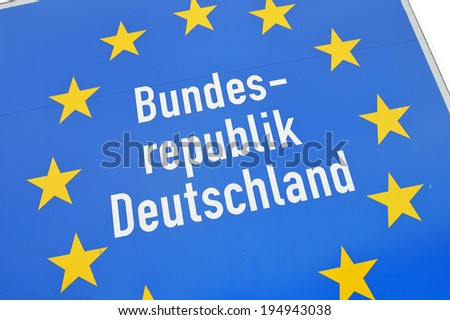 Close-up of a sign at the border of  Germany a member state in the European Union - Bundesrepublik Deutschland german for Federal Republic of Germany - stock photo