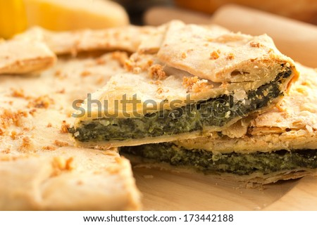 close up of a slice of spinach pie  - stock photo