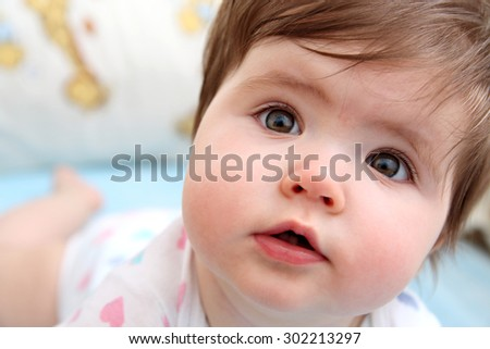 Close up of a small girl face with two teeth