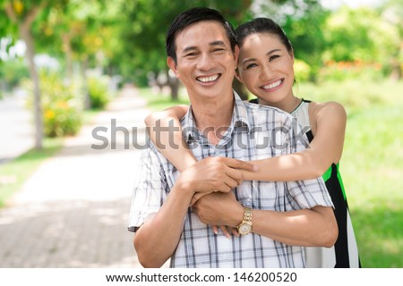 Close-up of a smiling couple in the park - stock photo