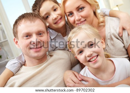 Close-up of a smiling family of four