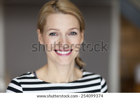 Close up Of A Smiling Italian blond woman - stock photo