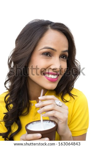 Close-up of a smiling woman drinking milk