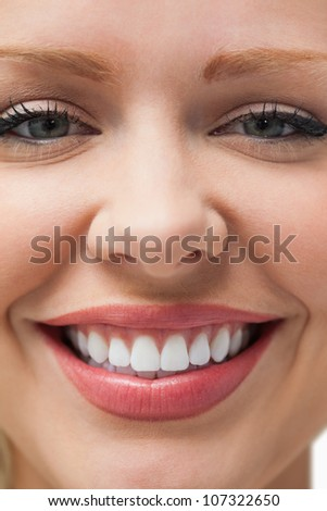 Close-up of a smiling woman staring at the camera - stock photo