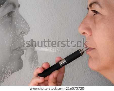 Close up of a smoker who has replaced the cigarette with electronic cigarette - stock photo