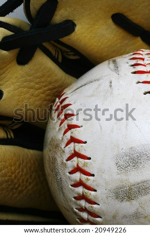 Close up of a softball ball and glove - stock photo