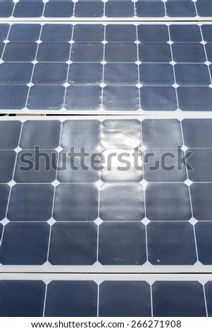Close up of a solar panel with sunlight reflection - stock photo