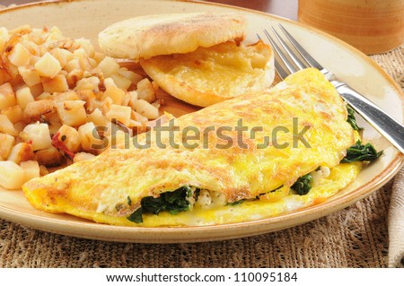 Close up of a spinach and feta cheese omelet with an english muffin - stock photo