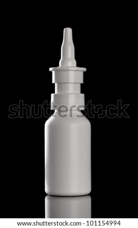 close up of  a spray bottle drops on black background - stock photo