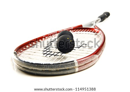 Close up of a squash racket and balls - stock photo