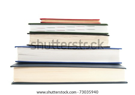 Close-up of a stack of books isolated on white background