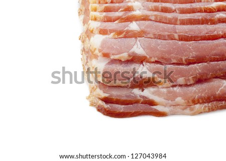 Close-up of a stack of raw bacon displayed on white background. - stock photo