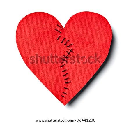close up of  a stitched paper broken heart on white background with clipping path - stock photo