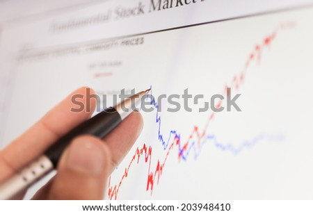 Close-up of a stock market graph on a computer screen - stock photo