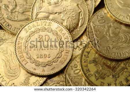 Close up of a stock of Gold french and american coins - stock photo