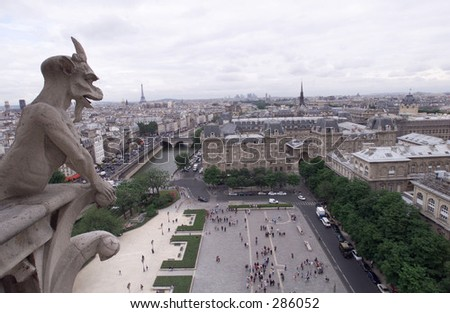 Close-up of a stone gargoyle mounted on a building, Paris, France, July 2001 (Keith Levit)