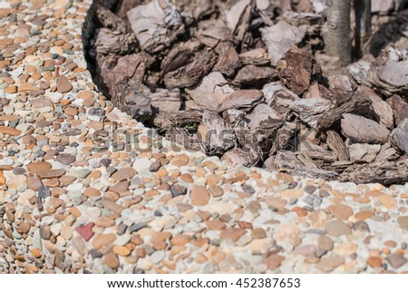 Close up of a stone wall background texture. Small sand pebbles