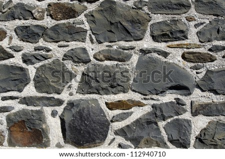 Close up of a stone wall of the stone store building in Kerikeri, Northland New Zealand. - stock photo