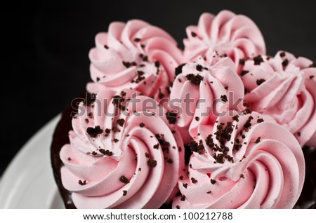 Close Up of a Strawberry Frosted Chocolate Torte Cake - stock photo