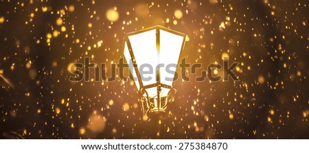 Close-up of a street lamp in a snowy night