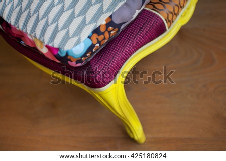 Close up of a stylish patchwork on a wooden floor