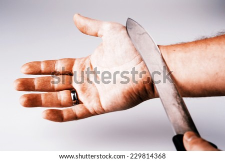 Close up of a suicidal man hand on isolated white background - stock photo