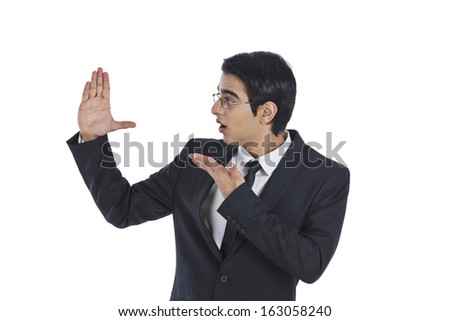 Close-up of a surprised businessman gesturing