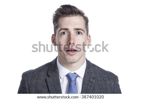 Close-up of a surprised young businessman on white background. - stock photo