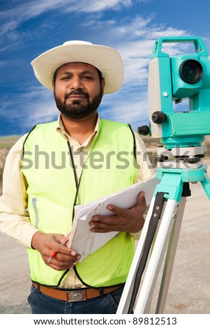 close up of a surveyor on the construction site. - stock photo