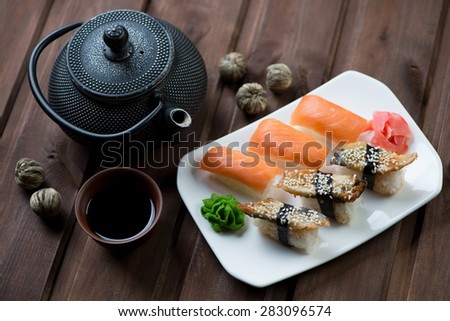 Close-up of a sushi set with soy sauce and tea, selective focus - stock photo